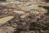 Gold mine on former Panara territory showing miners settlement and mercury washing pools  deforestation and pollution.Garimpeiro                      prospectors have displaced the Panara  formerly kn...