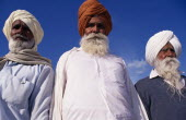 Three elderly Sikh men  head and shoulders portrait from low angle looking up3 Asia Asian Bharat Inde Indian Intiya Male Man Guy Old Senior Aged Religion Religion Religious Sihism Sikhs
