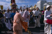 Hare Krishna taking part in a parade on Brighton seafrontEuropean Great Britain Northern Europe UK United Kingdom