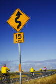 Cyclists descending from the summit of Haleakala on the longest free wheel road in the world.American North America Pacific Islands Polynesia United States of America Many Islands Polynesian Scenic...