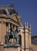 Palace detail with bronze statue of man on horse
