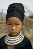 Head and shoulders portrait of a Meo girl wearing traditional dress and silver bars around her neck which are used as moneyMeo indigenous peopleAsian Classic Classical Historical Indegent Lao Older...