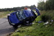 Scene of a road accident invoving a blue Peugeot car.RTA Automobile Automobiles Automotive Autos Cars European Motorcar Crash Autom�vil