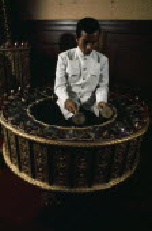 Musician playing Burmese circular drum at School of Music and Dance.Percussion InstrumentDrumsAsian One individual Solo Lone Solitary Prathet Thai Raja Anachakra Thai Siam Southeast Asia Southern...