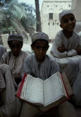 Boys at Koranic schoolKids Learning Lessons Middle East Northern Omani Religious Teaching Religion