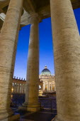 Vatican City The Basilica of St Peter and the square or Piazza San Pietro illuminated at night seen through the columns of BerniniEuropean Italia Italian Roma Southern Europe Catholic Principality Ci...
