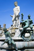 The 1575 Mannerist Neptune fountain with the Roman sea God surrounded by water nymphs commemorating Tuscan naval victories by Ammannatti in the Piazza della Signoria beside the Palazzo VecchioEuropea...