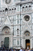 The Neo-Gothic marble west facade of the Cathedral of Santa Maria del Fiore with tourists walking in the square at the frontEuropean Italia Italian Southern Europe Toscana Tuscan Firenze Holidaymaker...