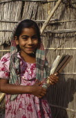 Portrait of young girl smiling holding writing slate. Asia Asian Bangladeshi Happy Immature Kids Learning Lessons One individual Solo Lone Solitary Teaching Asia Asian Bangladeshi Happy Immature Kid...