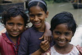 Head and shoulders group portrait of three smiling young girls.3 Asia Asian Bangladeshi Happy Immature Kids Contented Young Unripe Unripened Green 3 Asia Asian Bangladeshi Happy Immature Kids Conten...