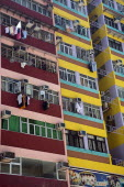 Freshly painted colored block of flats  typical workers home with hanged laundry and air condition units outside of the apartments windows.UrbanLandscapeContemporaryTourismHolidaysSummerDesign...