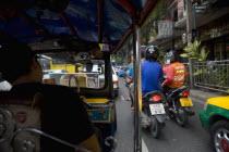 Ratchadamronen Klang Road. Treffic buy with scooters  Rickshaws and Tuk Tuk sAsian Blue Clouds Cloud Sky Ecology Entorno Environmental Environnement Gray Green Issues Prathet Thai Raja Anachakra Thai...