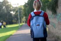 Girl walking to school with her rucksack full of books.UKEnglandUnitedKingdomGreat BritainEuropeEuropeanEducationLearningGirlFemaleChildStudentBagSatchel British Isles Children Immature...