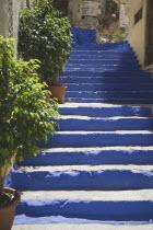 Flight of blue painted stone steps leading from Yialos harbour uphill to Chorio village. AegeanGreek IslandsSimicoast coastalseaSummerpackageholidayresortvacationtripdestinationDestinatio...