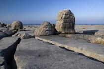 Boulders lie on a limestone section near Black Head with Atlantic behind.Eire European Irish Northern Europe Republic Ireland Poblacht na hEireann Blue Gray Karst Sedimentary Rock Scenic