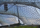 Germany, Bavaria, Munich, Olympic Stadium, Olympiastadion, Built as the main venue for the 1972 Summer Olympics, Large sweeping canopies of acrylic glass stabilised by steel cables meant to represent...