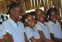 Caribbean, Haiti, Isla Laganave, Young School Girls in Blue uniforms.