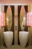 GERMANY, Saxony, Dresden, Washroom in restaurant with two washbasin sinks and matching mirrors.