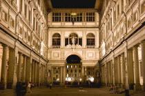 ITALY, Tuscany, Florence, The 16th century Vasari corridor of the Uffizi illuminated at night.