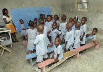 HAITI, Isla de la Laganave, school children in class with teacher.