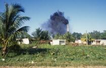 CUBA, Varadero, Sugar cane factory emitting clouds of black smoke from chimneys.