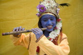 England, London, Hindu Festival, Child dressed as Lord Krishna.