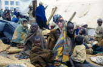 Congo, Bukavu, Rwandan refugees wrapped in blankets without shelter.