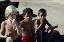 BrazilL, Para, Obidos, Children of different races eating Ingo Bau fruits.