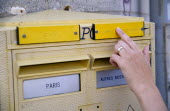 France, Ile de France, Paris, Letter post box with Braille incription for the blind and a female hand reading the raised text.