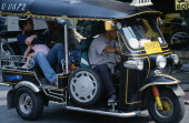 Thailand, North, Chiang Mai, Local family with young child as passengers in a Tuk Tuk three wheeled motorbike taxi.