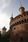 Poland, Krakow, turrets of the Barbican fortress with St Florian's gate in the background left.