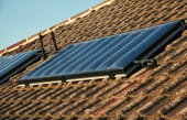 Environment, Energy, Solar Power, Solar panels on the roof of a house.