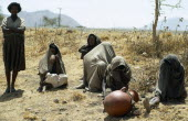 Ethiopia, Drought, Famine victims on parched land.