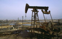 Azerbijan, Polluted wasteland with nodding donkey of oil field near Baku.