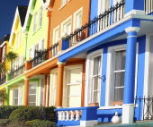Ireland, County Anrtrim, Whitehead, Colourfully painted terraced houses with balconies.