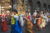 Hungary, Pest County, Budapest, Hare Krishna devotees singing and dancing on Andrassy UtIn Pest with graffiti covered doorway behind. The International Society for Krishna Consciousness or ISKCON, als...