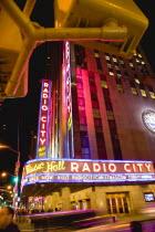 USA, New York, Manhattan, The Art Deco Radio City Music Hall on 6th Avenue and 50th Street illuminated at night.