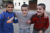 Albania, Berat, three smiling young boys.