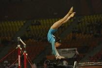 India, Delhi, 2010 Commonwealth Games, Female gymnastics, Asymmetrical bars exercise.