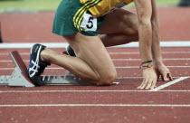 India, Delhi, 2010 Commonwealth games, Track event runner on his starting blocks.