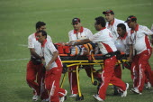 India, Delhi, 2010 Commonwealth games, Rugby game, injured player being taken off the pitch on wheeled stretcher.