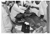 Bolivia, Santa Cruz, Vallegrande, Bolivian doctors preparing the body of Che Guevara for the insertion of formalin for preservation, in laundry room of Vallegrande hospital. Monday 09 October 1967.