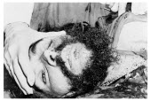 Bolivia, Santa Cruz, Vallegrande, Bloodstained head and body of Che Guevara being inspected by Bolivian doctors in laundry room of the local Vallegrand hospital, late afternoon Monday 09 October 1967.