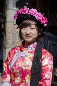 China, Yunnan Province, Lijiang, Mosuo girl wearing a colourful costume.
