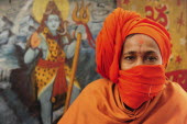 India, Uttarakhand, Hardiwar, Portrait of pilgrim at Kumbh Mela, Indias biggest religious festival where many different traditions of Hinduism come together to bathe in the Ganges.