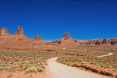 USA, Utah, winding dirt road through the Valley of the Gods.