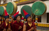India, Sikkim, Buddhist Monks playing drums in a Losar ceremony.