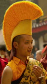 India, Sikkim, Buddhist  monk in a Losar procession.