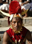 India, Nagaland, Naga Warrior tribal in traditional costume and head dress.