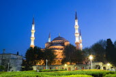 Turkey, Istanbul, Sultanahmet Camii, The Blue Mosque domes and minarets at sunset with son et lumiere light show.